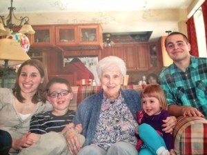 Me, my brother, and our younger cousins with our great-grandma at her 96th birthday party.