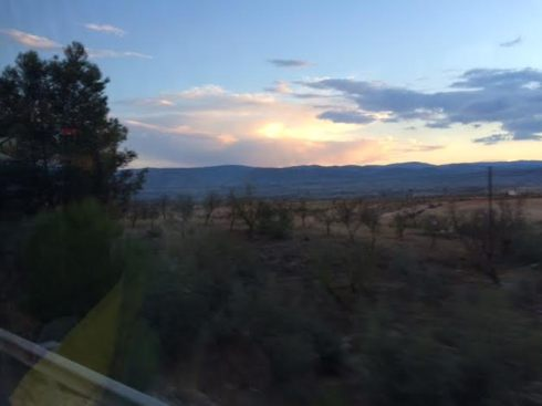 Sunset over the Sierra Nevada. (Picture taken with an iPhone 5S from a moving bus. I never claimed to be a pro.)
