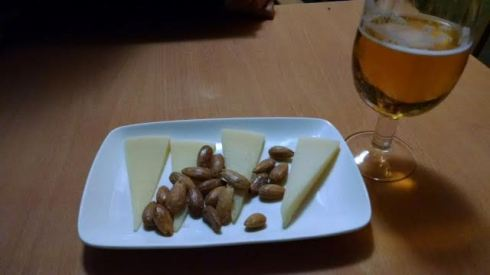 Tapa plate of manchego with almonds.