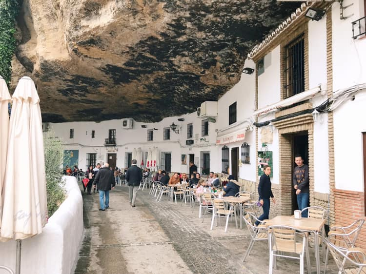 Setenil de las Bodegas, one of the white villages in Andalusia, Spain, was partially built into and under the overhanging mountain.