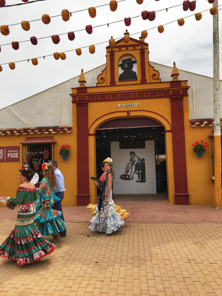 Women in flamenco dresses at the feria de Córdoba