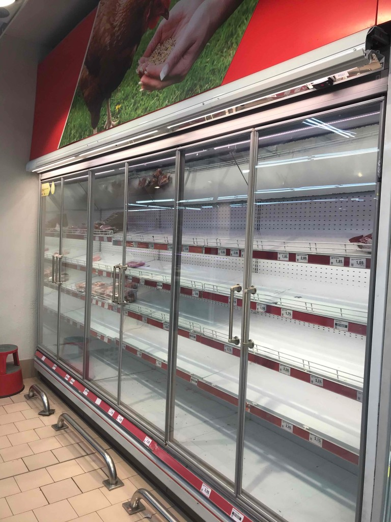 Empty shelves at a grocery store during the Coronavirus lockdown in Spain